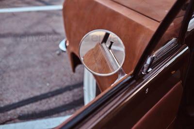 Opened door of a restored retro car.
