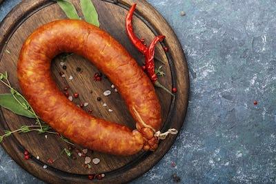 Smoked sausage on grey kitchen table