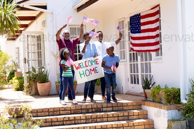 African American three generation family welcoming a soldier coming back home
