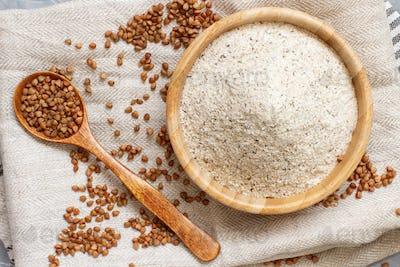 Buckwheat flour in a bowl buckwheat grain