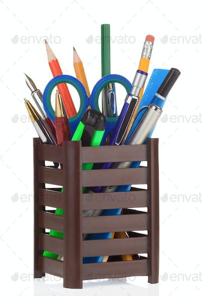 school accessories in holder on white