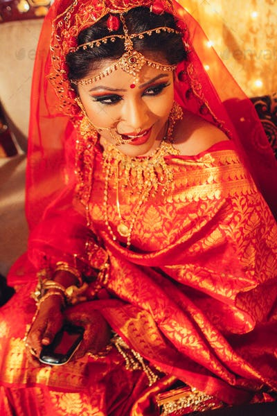 portrait of beautiful indian woman in traditional clothes looking away
