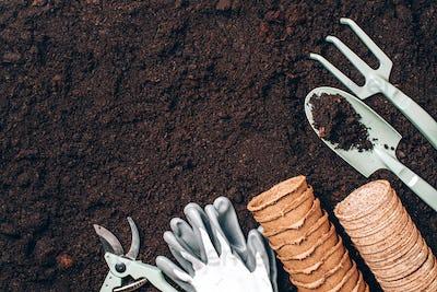 Spring agriculture, organic planting or ecology concept. Gardening tools, seeds, pruner, rake