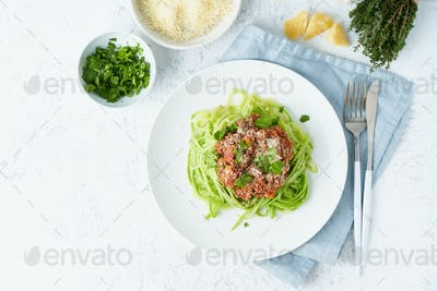 Keto pasta Bolognese with mincemeat and zucchini noodles, fodmap, lchf. Top view, copy space