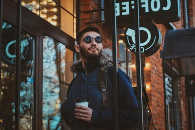 Portrait of attractive man with cup of coffee