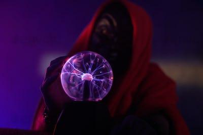 Portrait of wizard with magic globe
