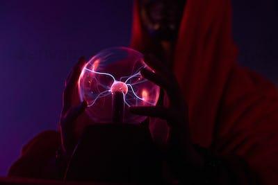 Futuristic shaman is using his magic globe