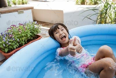 kid swim in inftable pool