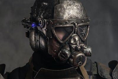 Man in metal helmet with gasmask
