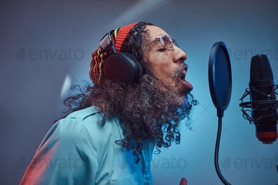 African Rastafarian singer male in the recording studio