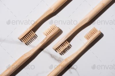 Top view of wooden toothbrushes on white background, zero waste concept