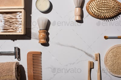 Top view of shaving and cosmetic brushes, comb, towel, toothbrushes