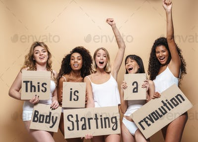 Image of excited multinational women screaming and holding placards