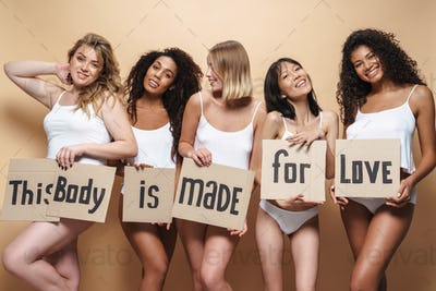Image of seductive multinational women smiling and holding placards