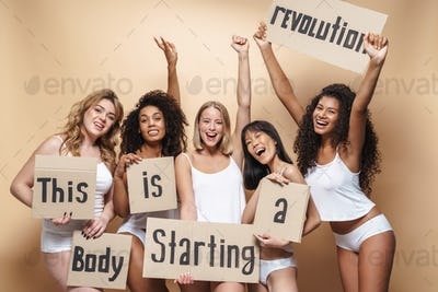 Image of excited multinational women smiling and holding placards