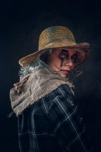 Portrait of attractive female in creepy ccarecrow role