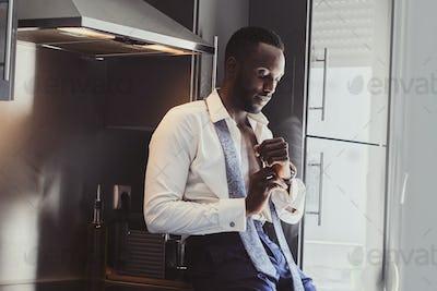 Portrait of elegant businessman at the kitchen