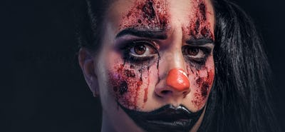 Portrait of evil creepy joker on Halloween
