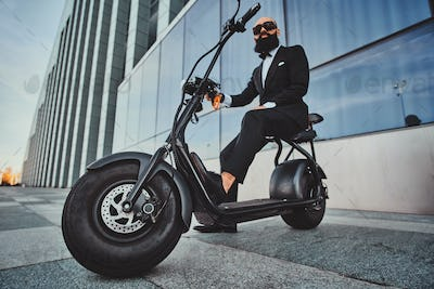 Man is riding his new electrical bike