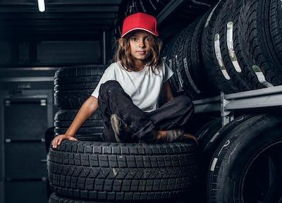 Portrait of a girl in dark tyre storage