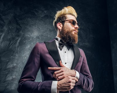 Bearded man with expressive style dressed in a violet elegant suit