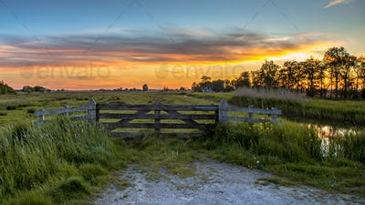 Wooden fence at sunset in Historic dutch landscape