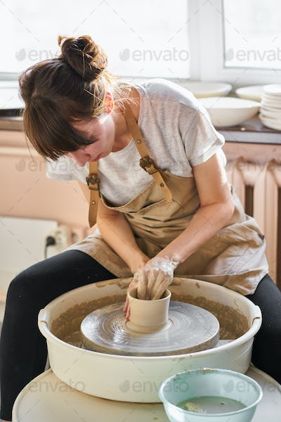 Woman freelance, business, hobby. Woman making ceramic pottery