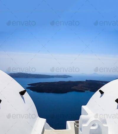 Santorini, Greece. White architecture detail against blue sea background.