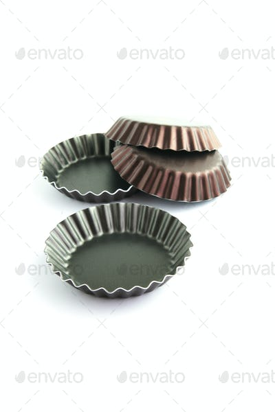 Four corrugated cake tins