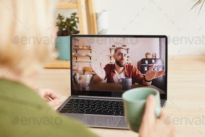 Man talking online to woman