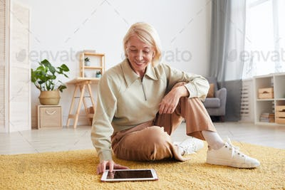 Woman watching something on tablet pc