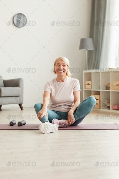 Happy woman resting after training