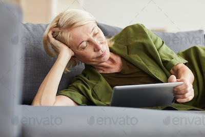 Woman resting with tablet pc
