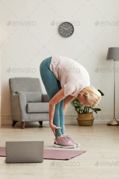 Woman stretching during exercises