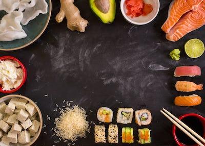Ingredients for sushi on dark background
