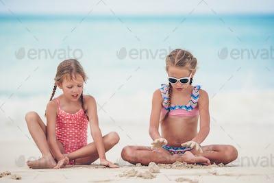 Happy kids running and jumping at beach
