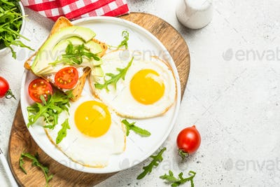 Healthy breakfast with egg, toast and salad