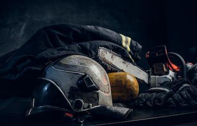 Safety gear, helmet, oxygen balon and chainsaw