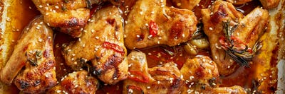 Barbecue chicken wings. Sticky asian spicy wings with teriyaki. Long width banner. Oven baked