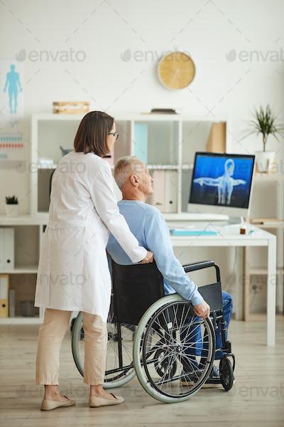 Handicapped Senior Man Visiting Doctor