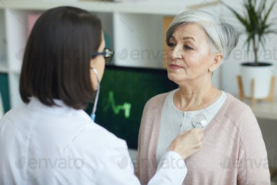 Doctor Listening to Heartbeat of Senior Patient