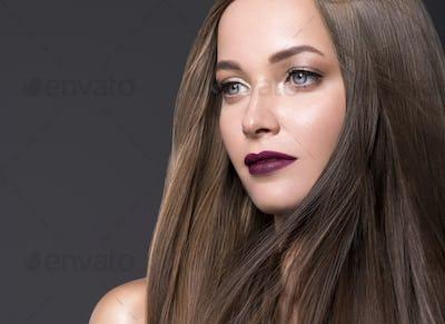 Beautiful brunette long smooth hair female portrait fashion make\