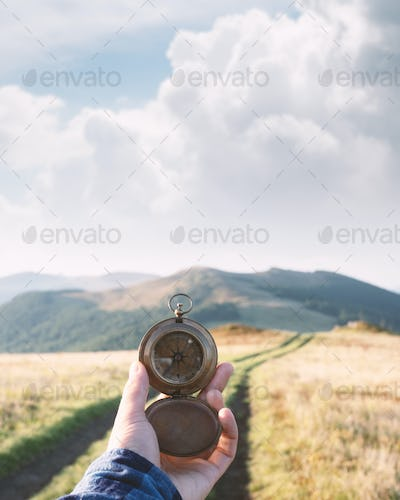 Man with compass in hand