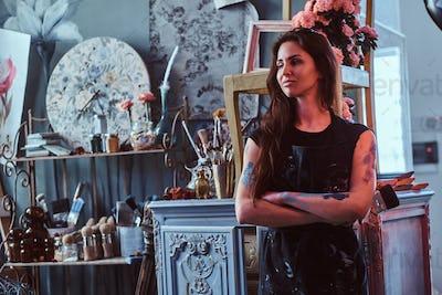 Beautiful painter in her own studio