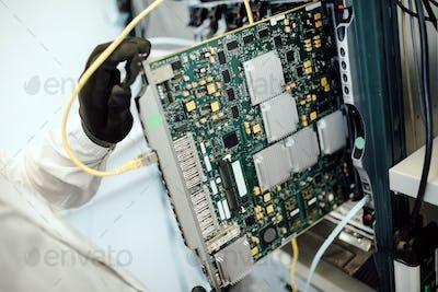 Technician repairing cmts cards