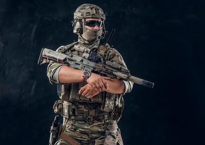 Military man in uniform with machine gun