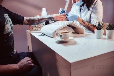 Hardware manicure in a beauty salon
