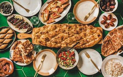 Muslim Ramadan iftar family dinner with Turkish foods, copy space