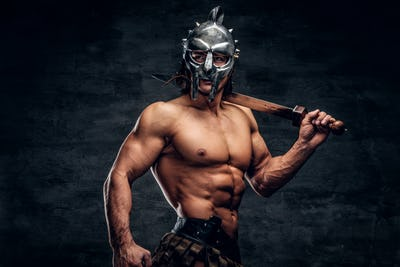 Strong gladiator with sword in his hands