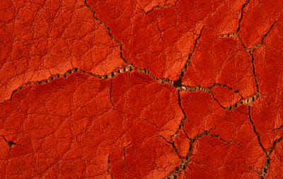macro closeup of brown cracked artificial leather